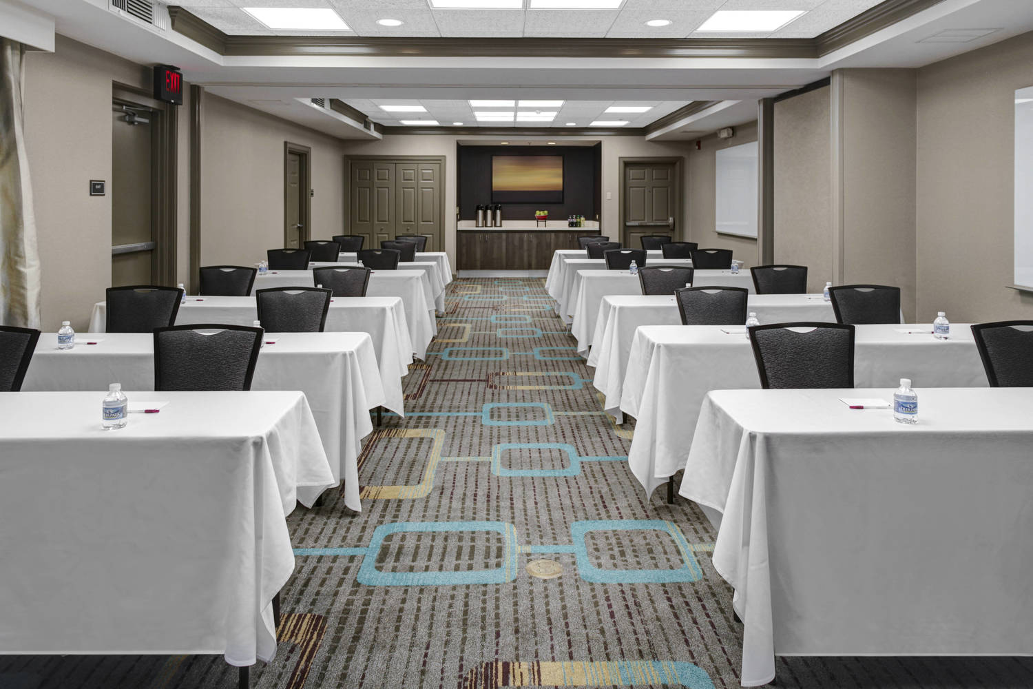Our 800 square-feet of meeting space can be separated into two meeting spaces. Newly added screen and glass boards are complimentary for a successful meeting. We also offer on-site catering available upon request.
